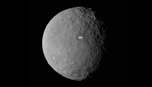 "The dwarf world Ceres' mysterious bright spots, discovered by NASA""s Dawn spacecraft in 2015. Credit: NASA"