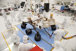 "NASA's Curiosity Rover being assembled in a ""clean room,"" a biologically-controlled space designed to minimize biological contamination."