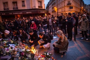 Parisians come out in mourning following the attacks. Photo credit: David Ramos/Getty Images